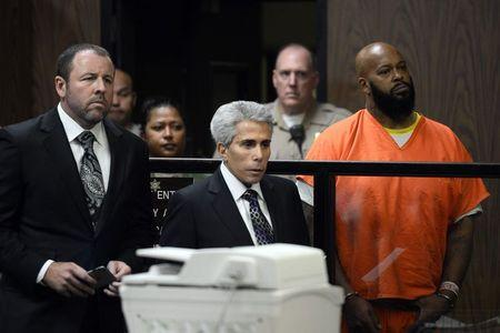 Rap mogul Suge Knight stands in court during his arraignment on murder charges in Compton, California