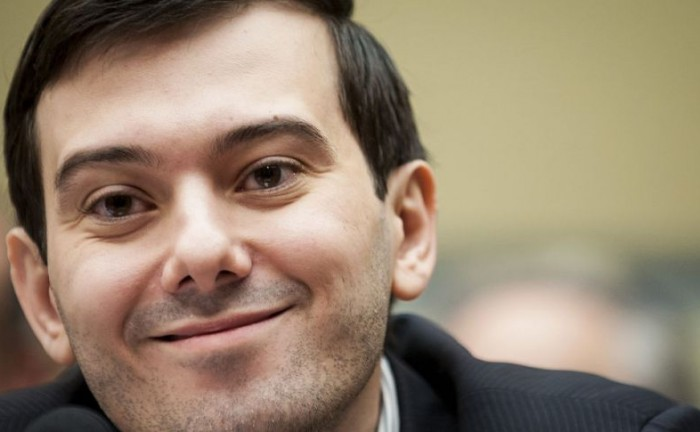 "Martin Shkreli, former chief executive officer of Turing Pharmaceuticals LLC, smiles while listening to opening statements at a House Committee on Oversight and Government Reform hearing on prescription drug prices in Washington, D.C., U.S., on Thursday, Feb. 4, 2016. Shkreli, who is no longer with Turing and faces federal fraud charges unrelated to the drugmaker, declined to make any comments to the committee. ""On the advice of counsel, I invoke my Fifth Amendment,"" Shkreli said. Photographer: Pete Marovich/Bloomberg via Getty Images"
