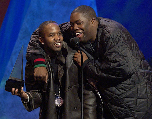 Big Boi, left, of the rap group Outkast, and Killer Mike, right, accept the award for Favorite Band, Duo or Group-Hip-Hop/Rhythm & Blues Music at the 30th annual American Music Awards, Monday, Jan. 13, 2003, in Los Angeles. (AP Photo/Mark J. Terrill)